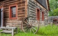 Old Homestead with Wagon Wheel
